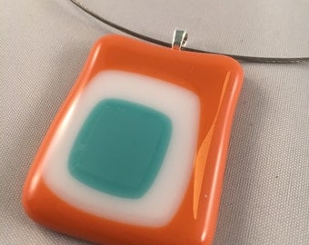 Orange tesl and white pendant