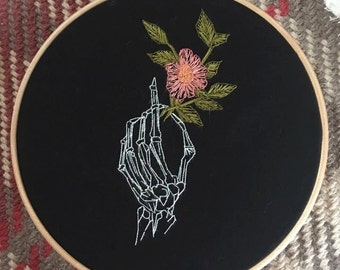 Floral skeleton hand embroidery