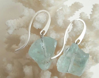 Silver earrings and rough stones rock crystal stones