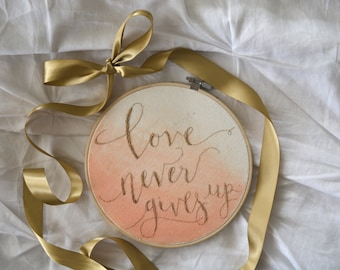 """Watercolor Coral Ombre """"Love Never Gives Up"""" Embroidery Hoop"""