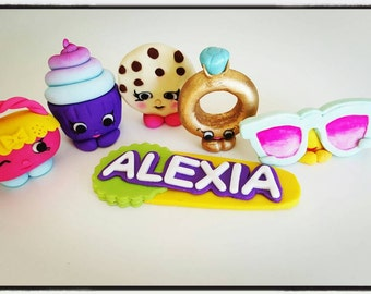 5 x Shopkins cake toppers plus name plaque
