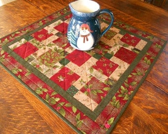 Quilted Christmas Wall Hanging/Table Topper in Christmas fabrics of green, red, beige