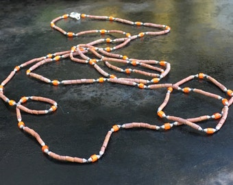 Extra long necklace of Afghan heishi beads, orange whitehearts and Bali silver