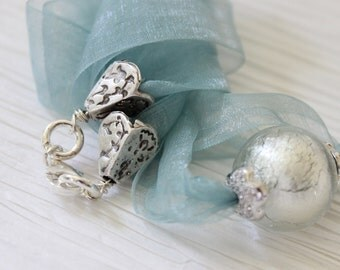 Venetian glass bead  and sterling silver findings on silk blend dusty blue ribbon