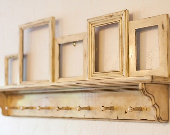 Distressed wall shelf with picture frames, coat hanger