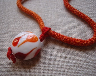 Crocheted necklace, fine cotton necklace with glass pendant, red and orange necklace, fine cotton crochet necklace, large textile necklace.