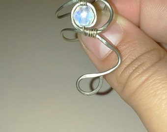 Metal ring with stones