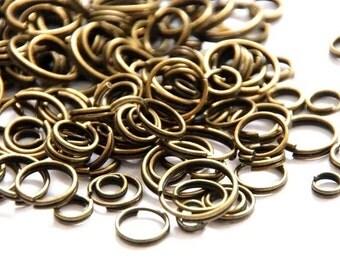 100 split rings 4 mm - 10 mm / MIX, bronze