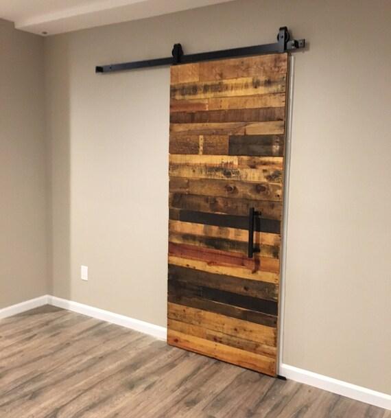 Custom sliding barn door reclaimed stacked pattern from for Sliding barn door construction plans