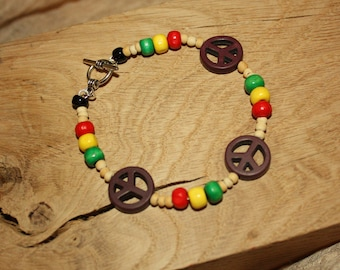 Beaded Natural Rasta Bracelet with coloured wood beads and howlite peace signs.