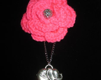 A charming pink crocheted rose, with a delightful elephant charm. Pin, hair jewelry, or a necklace by, whyeverbeordinary