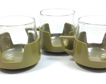 Three 1960's green plastic and glass mugs