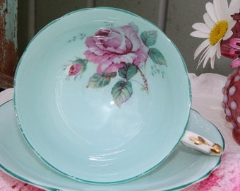 Paragon:  Turquoise tea cup and saucer with beautiful pink rose