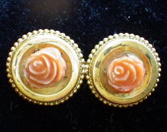 Carved coral gold-plated brooch