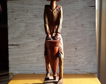 Wood Carving of a Jamaican Man Playing the Bongo. Very nicely done.  Not signed by the Artist.  Unique. One-of-a-kind.