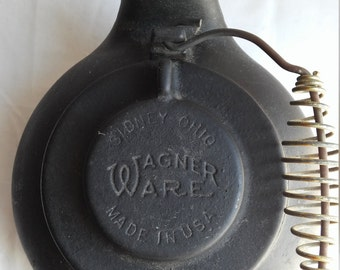 """Vintage 1909 Wagner Ware 9"""" Kettle.  Very nice condition for the age and the handle is intact."""