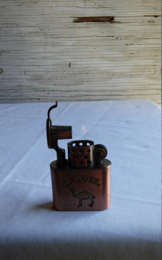 Vintage Bronze Tone Camel Cigarettes Advertising Lighter. In Working Condition. Gently used Condition.