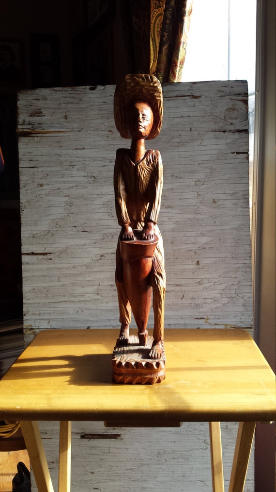 Wood Carving of a Jamaican Man Playing the Bongo