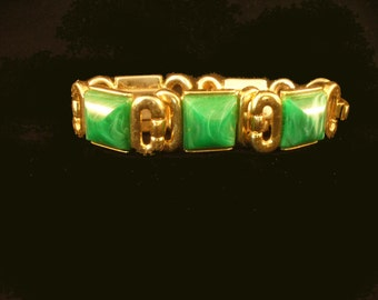 Crown Trifari bracelet, gold tone and green lucite, vintage