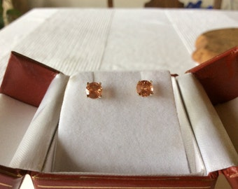 Gorgeous and unique Red Oregon Sunstone post earrings! 14 kt gold setting. Hand mined and hand made. Stunning and sparkling!