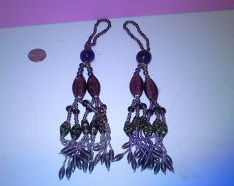2 purple beaded tassels