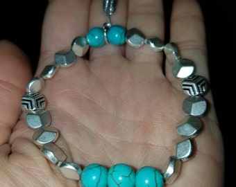 Turquoise beaded stretch bracelet with silver spacers