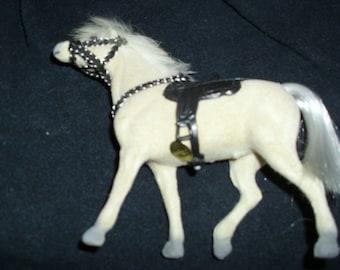 2 WHITE SADDLED HORSES
