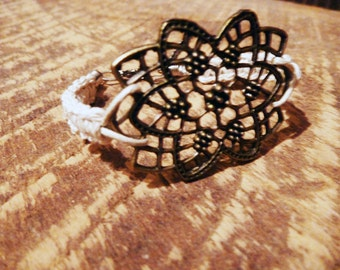Braided strap and metal charm