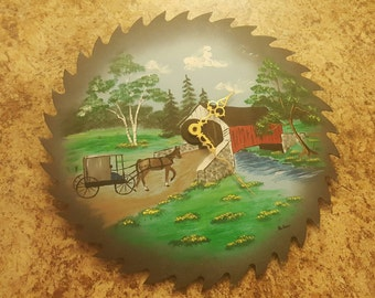 Real saw blade clock. Handpainted clock.
