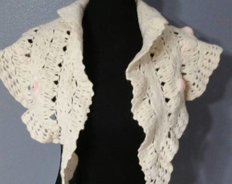 Cream hand knitted shawl with beautiful pink blossoms