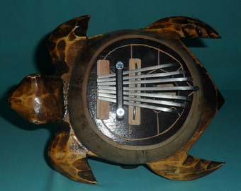 Thumb piano carved in coconut shaped turtle. Musical instrument used in south east Asia. Beautiful object and nice sound.