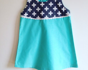 Turquoise dress and cross
