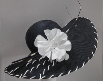 No. 3932 A black parasisol picture hat with pleated brim.