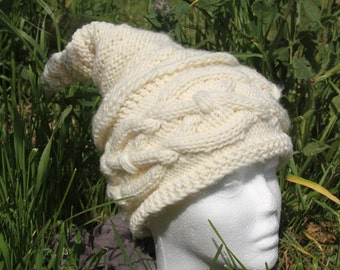 Off-white hat with cables knitted hand