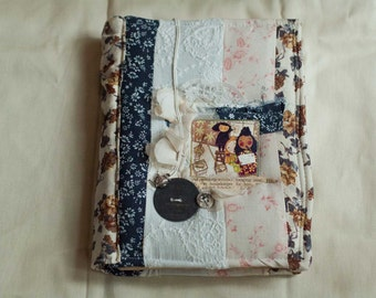 Book with soft patchwork fabric cover and coffee-dyed paper