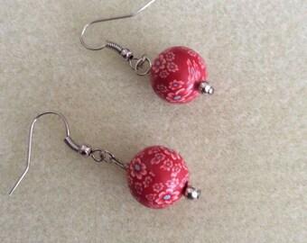 Red daisy dangle earrings