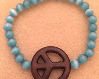 Blue Cats Eye Bracelet with Peace Sign