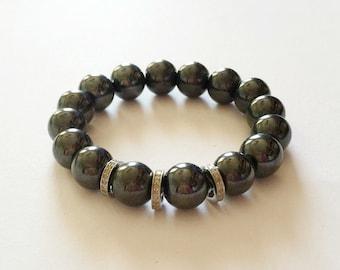 Hematite gemstone and 0.66 carat diamond bracelet
