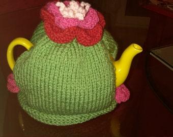 Handmade knitted tea cosy