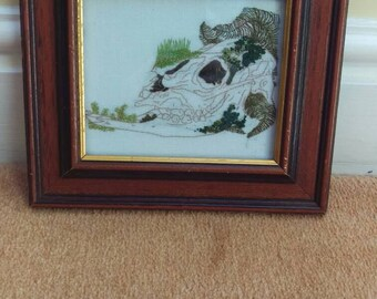 Horse skull embroidery with ferns and moss, in vintage frame.