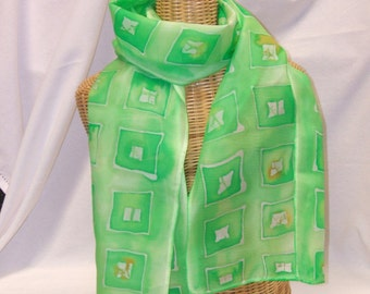 Hand painted pure silk scarf, batik, greens with a hint of orange, geometric design.