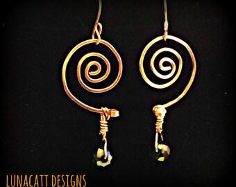 Stunning handmade spirals of copper~  Shown with a emerald green glass bead
