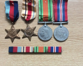 British World War 2 Medal Group and Bar. 1939-45 Star, Africa Star, War Medal and Defence Medal
