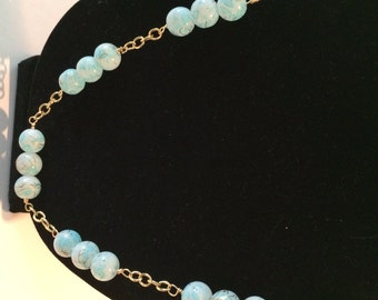 Light Blue, gold flecked glass beads with wire wrap