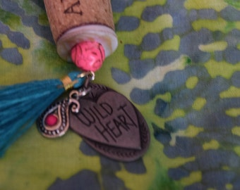 wine cork repurposed into beautiful charm necklace