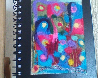 An A5 sketchpad with needle felt cover