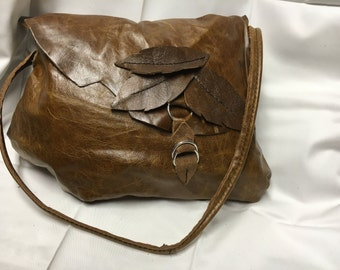 Leather handbag with leather leaf detail