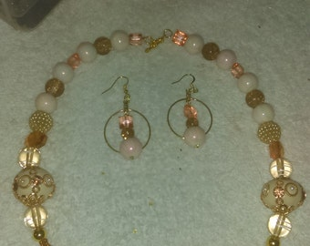 Two piece set includes Necklace and earrings .