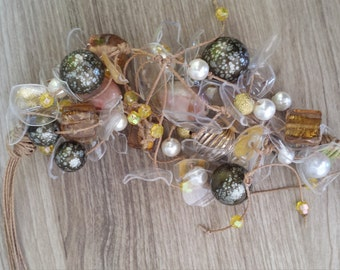 Pet necklace full of plastic and glass beads