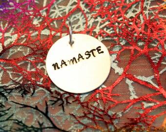 Namaste stamped pendant
